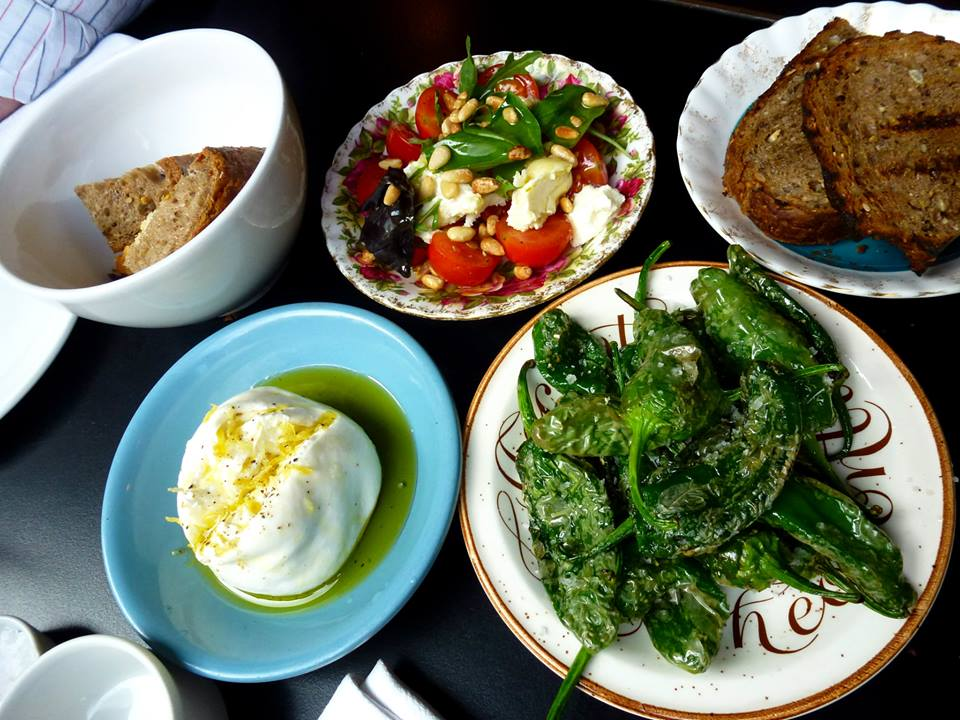 Burrata, padron peppers flecked with sea salt, goat's cheese salad with cherry tomatoes, pine nuts