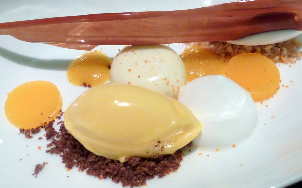 Cardomom panna cotta, mandarin sorbet, chocolate steusal, clementine and coconut dessert at L'autre pied