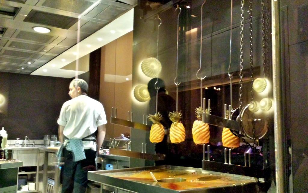 Spit roasting pineapples for tipsy cake at dinner by heston blumenthal
